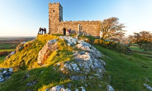 A view of St Michael's Church on top of Brent Tor at sunset.