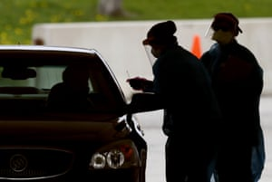 Healthcare worker test a resident at a drive-through Covid-19 testing site in Waterloo.