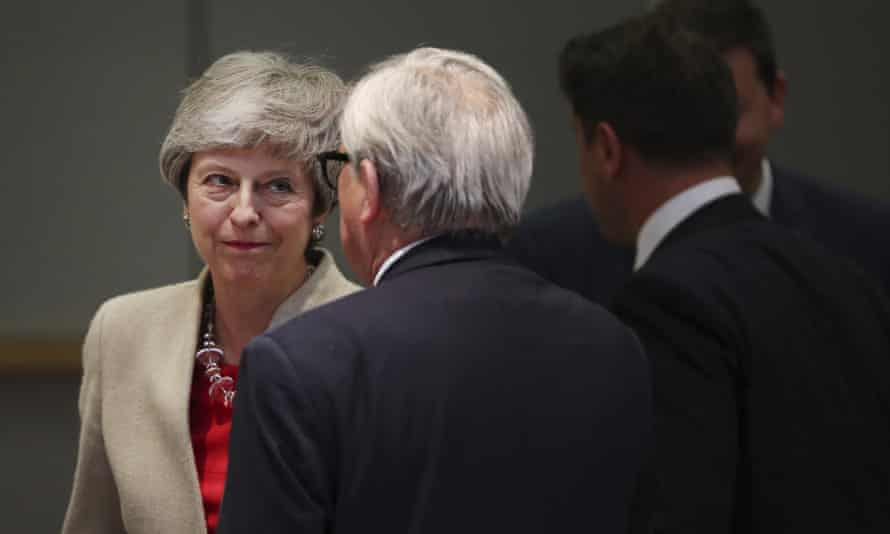Theresa May with Jean-Claude Juncker at the EU summit in Brussels.