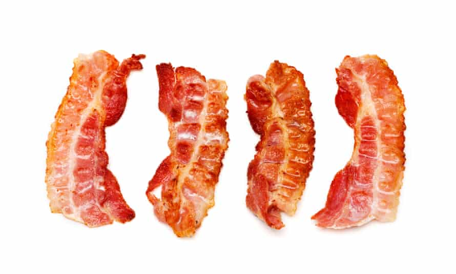 Slices of bacon on a white background.