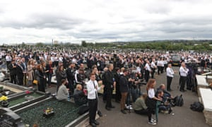 A crowd listens to former Sinn Fein president Gerry Adams speaking at the funeral of Bobby Storey at Milltown Cemetery in west Belfast yesterday.