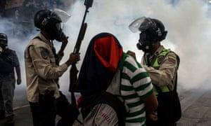Authorities arrest opposition demonstrators during a protest in Caracas, Venezuela.