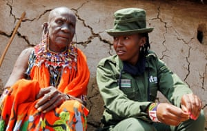 Amboseli, Kenya: Sharon Karaine from the Team Lioness all-female Kenyan rangers talks to her grandmother after a recent visit to the Risa camp to deter people from poaching