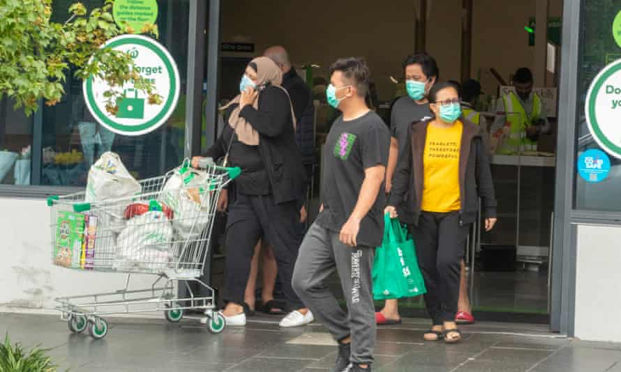 Shoppers leaving the Woolworths supermarket in Berala, which has been linked to a coronavirus outbreak along with a BWS store. Nearly half the people who live in the Cumberland municipality, which covers Berala, were born overseas.