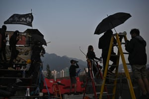 Hong Kong Protesters stand on a bridge over the Tolo highway as they gather at the Chinese University of Hong Kong.