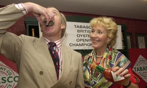 Neil Hamilton tries an oyster watched by his wife Christine, at the British Oyster Opening Championships in 2001.