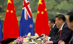 Chinese and new zealand flags at a Xi meeting