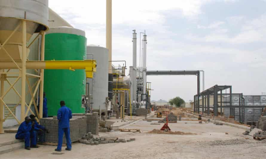 Workers sit outside the brewery, which gas been a source of national pride for South Sudan.