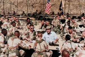Bush eats with troops in Saudi Arabia during Operation Desert Shield, in the build-up of troops before the Gulf war, in November 1991.