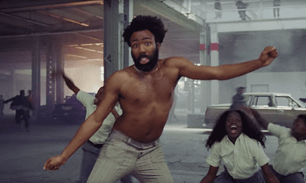 Glover's attention-grabbing dance moves seem to be making a point about what society focuses on.