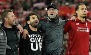 Virgil van Dijk (right) looks out in wonder as Jürgen Klopp and Mohamed Salah sings 'You'll Never Walk Alone' in front of the Kop.