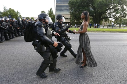 A demonstrator protesting the shooting death of Alton Sterling is detained by law enforcement near the headquarters of the Baton Rouge Police Department