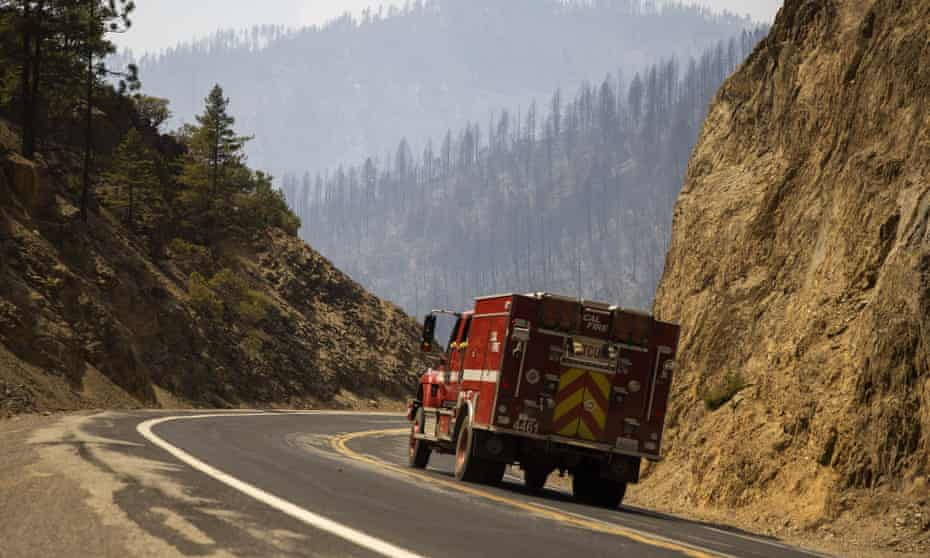 A Cal Fire engine navigates along Hwy 70 near the burn zone of the Dixie fire on Thursday, 22 July, 2020 in Plumas County, California.