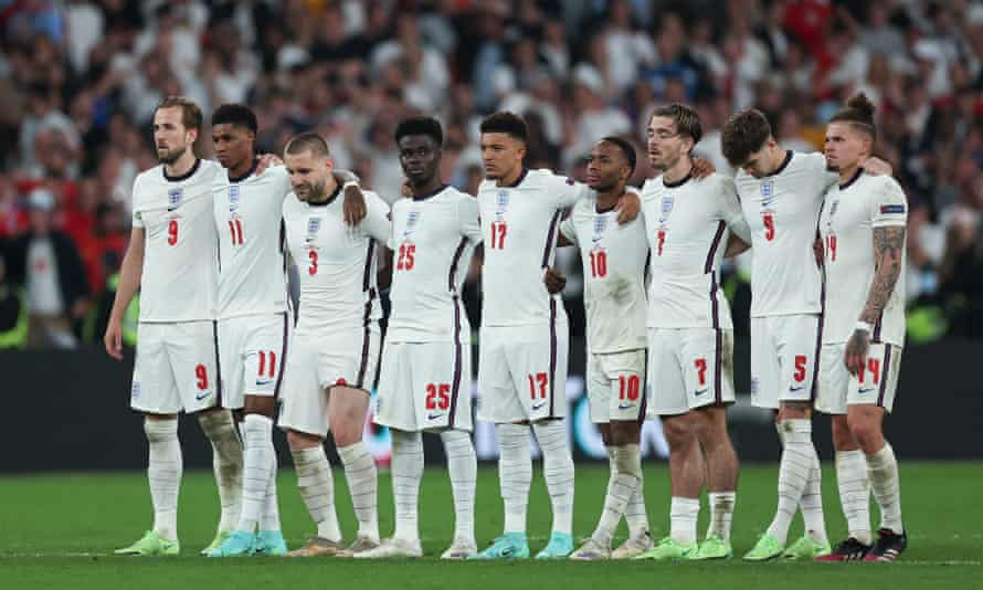 England players stand on the halfway line during the penalty shootout against Italy.