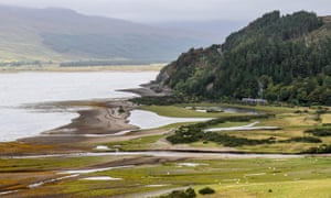 A Scotrail train crosses the glacial delta estuary of the River Attadale on the Kyle of Lochalsh railway line in the Highlands of Scotland.