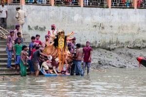 Immersion of goddess Durga at Ichamati, Taki.