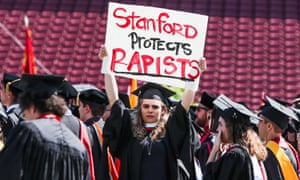 A woman carries a sign in solidarity for a Stanford rape victim during graduation at Stanford University, in Palo Alto, California.