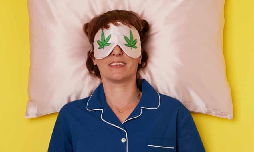 Zoe Williams resting on a pillow, in pyjamas, wearing eye mask