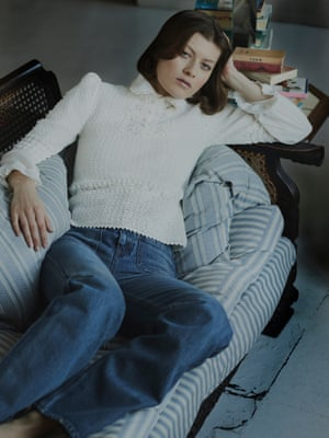White blouse with frill collar, £1,300, crochet knit, £1,800, and cropped flare bell jeans, £490, all celine.com