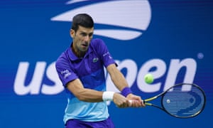 Novak Djokovic plays a backhand early in the match.