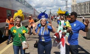 Fans arrive from Moscow by a free double-decker train for Brazil's quarter-final with Belgium in Kazan.