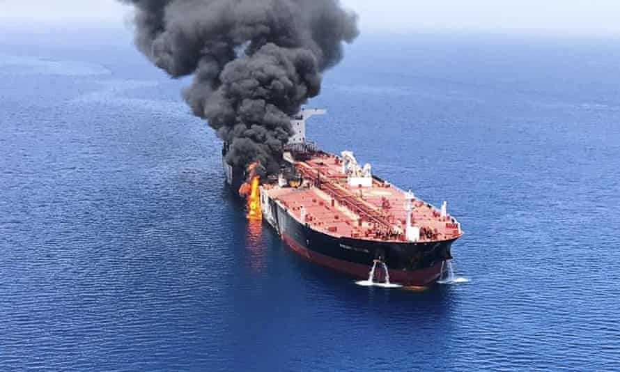An oil tanker on fire in the Gulf of Oman