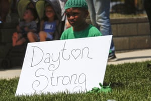 Dayton, Ohio: A boy holds up a sign of encouragement