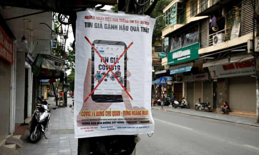 A poster warning against the spread of 'fake news' on the coronavirus in Hanoi, Vietnam.