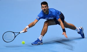 Novak Djokovic stretches to play a forehand.