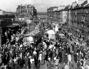 The following day Celtic fans rush to mob the Celtic team bus as it arrives at Celtic Park, carrying the European Cup and the triumphant team