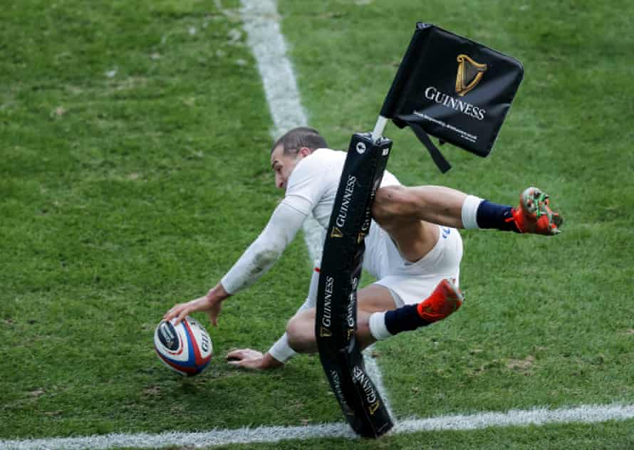 Jonny May acrobatically scores for England.