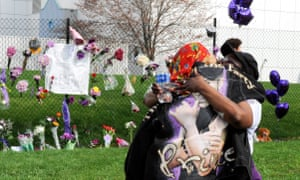 Sheila Clayton of St Paul, Minnesota, (L) hugs an unidentified friend outside of Paisley Park, the home and studio of Prince.
