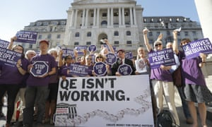 Positive Money campaigners protest against quantitative easing in front of the Bank of England in 2016.