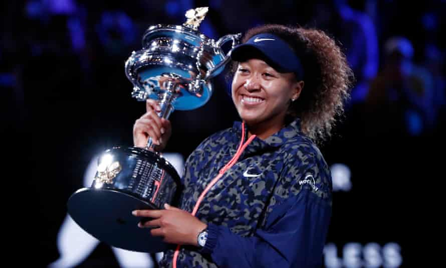 Naomi Osaka with the Daphne Akhurst Memorial Cup after her straight-sets win against Jennifer Brady, who was in her first slam final.