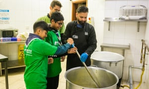 Jewish and Muslim volunteers prepare the soup for distribution to homeless centres.