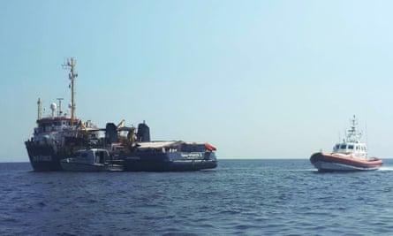 An Italian coastguard boat next to Sea-Watch 3