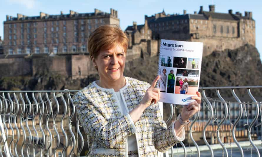 Nicola Sturgeon holds the policy paper on migration at its launch in Edinburgh