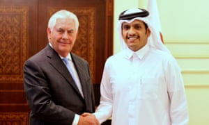 Qatar's foreign minister shakes hands with the US secretary of state. Rex Tillerson said: 'Together the United States and Qatar will do more to track down funding sources.'