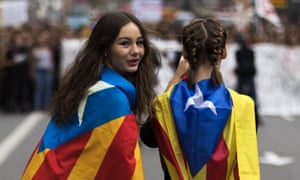 Students wearing Catalan flags at a protest before the independence referendum.