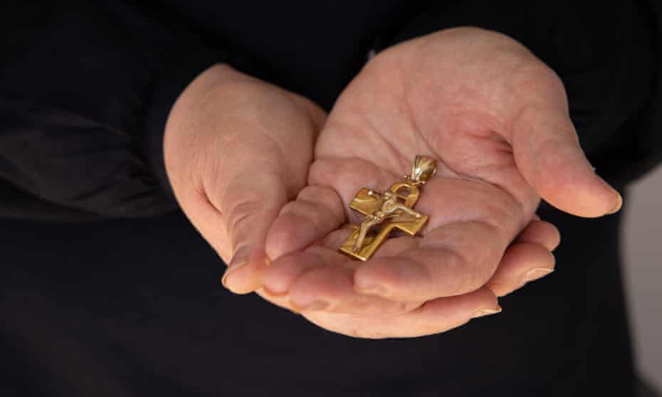 Najwa Rizk holds her husband's crucifix