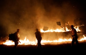 Amazonas state, Brazil,Brazilian Institute for the Environment and Renewable Natural Resources (IBAMA) fire brigade members attempt to control hot points during a fire at Tenharim Marmelos Indigenous Land