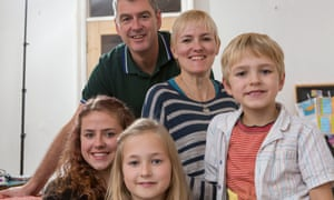 Chris Taylor and Jan Farringdon at home with their children, Eshe, Jini-Rose and Mac.