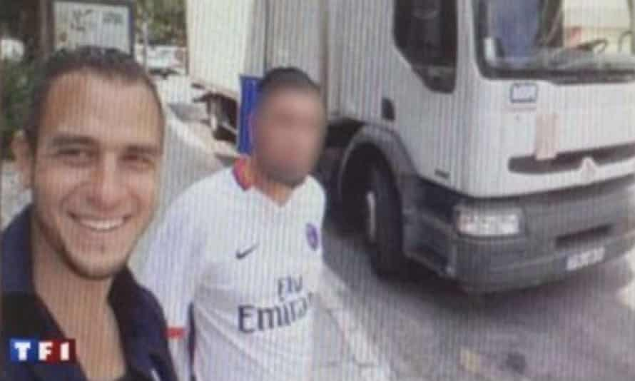 Lahouaiej-Bouhlel poses outside the truck with another man.