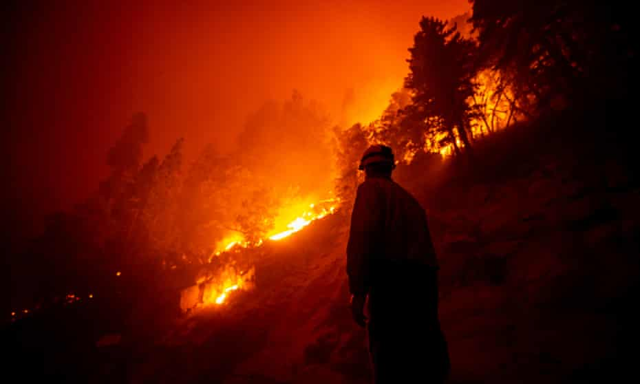 A firefighter checks on the evolution of the Castle Fire as it burns in the Sequoia national forest in September.