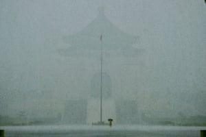 Taipei, Taiwan: A man walks in heavy rain caused by Tropical Storm Choi-Wan in front of the Chiang Kai-shek Memorial Hall.