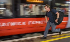 A man running for the Gatwick Express train at London Victoria station