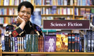 Octavia Butler poses for a photograph near some of her novels at University Book Store in Seattle, Washington