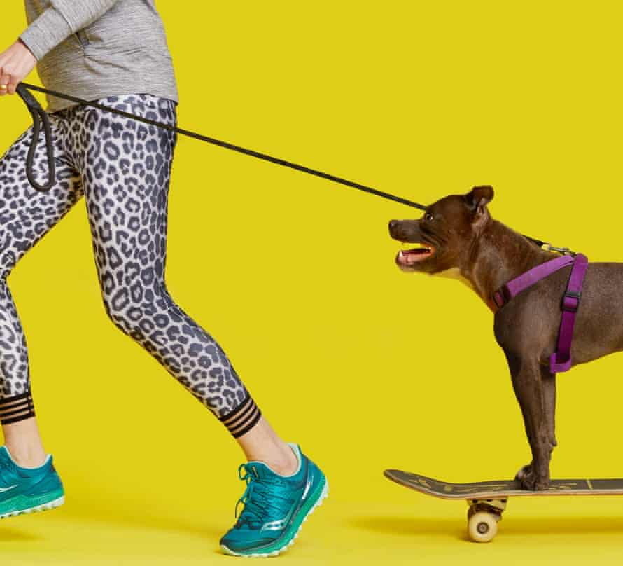 Zoe Williams running with dog on a skateboard