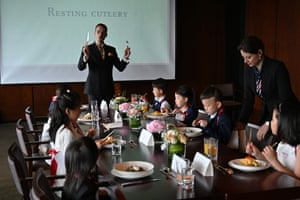 Guillaume de Bernadac teaches children how to use cutlery during an etiquette and manners class in central Shanghai