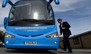 David Cameron gets on to his battlebus during the 2015 campaign.